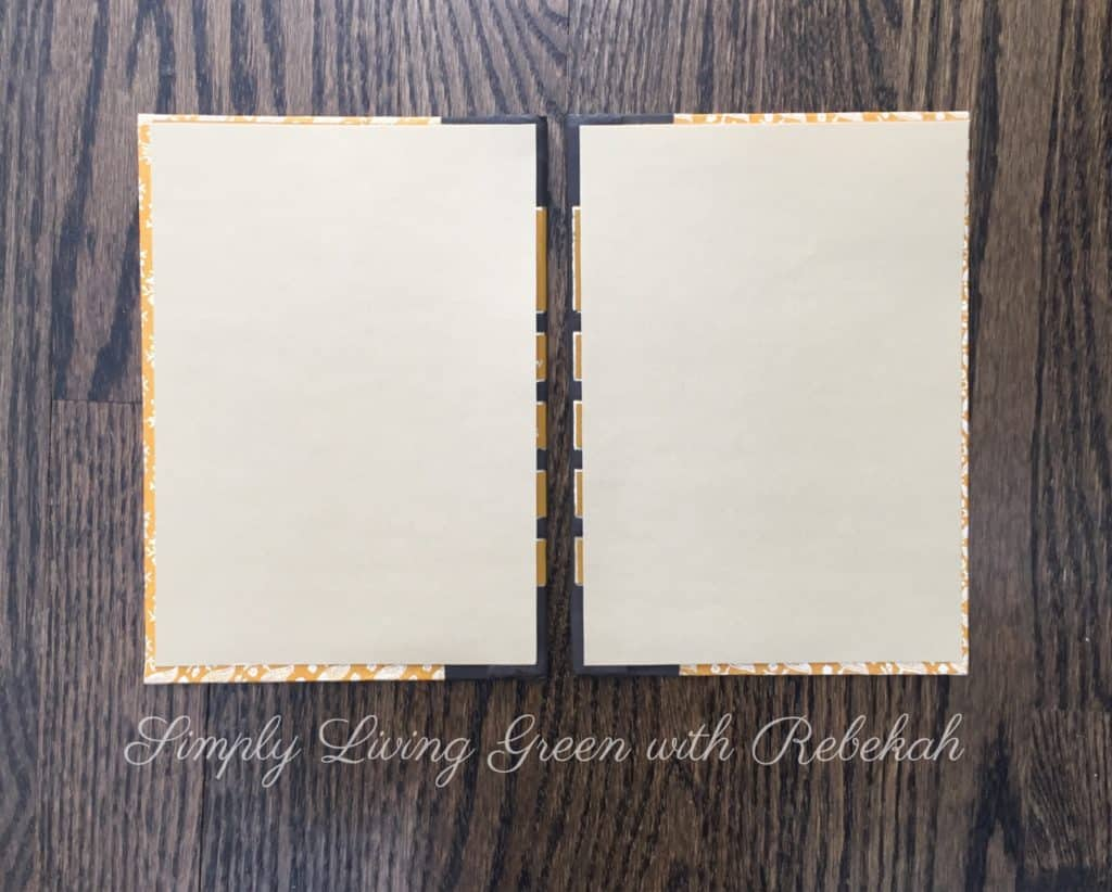 Next, cut decorative or colored paper to coordinate with your book covers and use spray adhesive to glue them on the inside of the front and back covers.