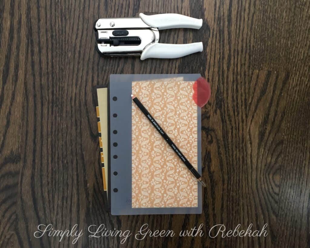Then, using your 3-hole punch, create a template for where your holes will be in the cover and filler paper.