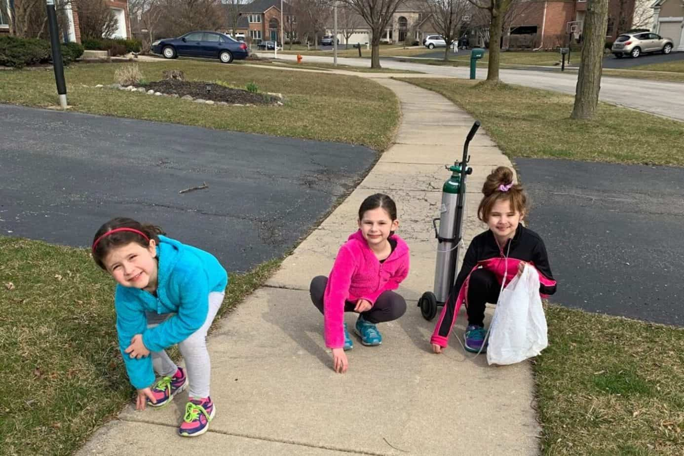 girls doing neighborhood cleanup