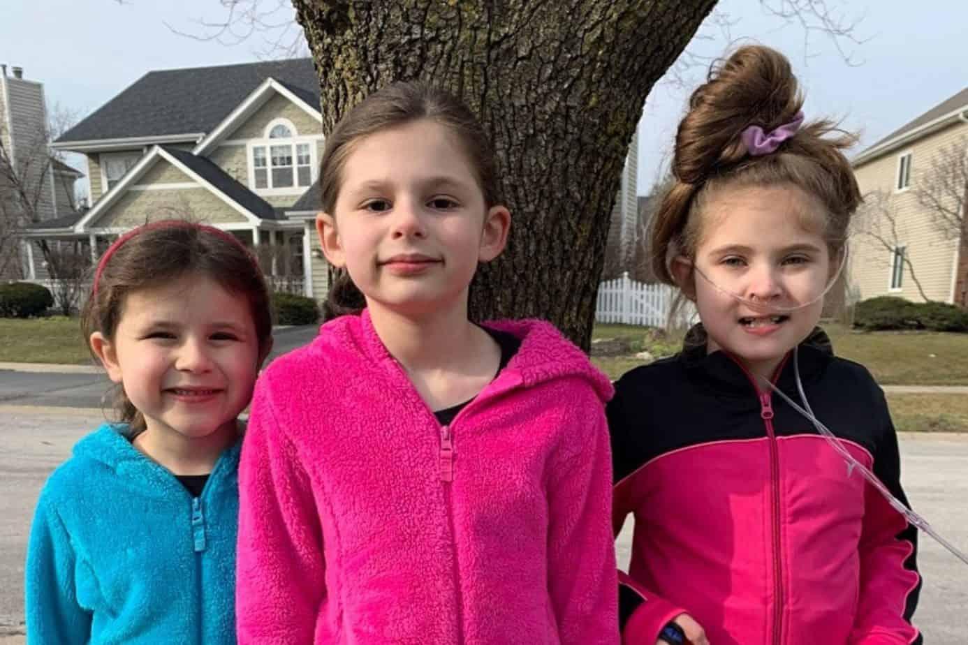 daughters doing neighborhood cleanup