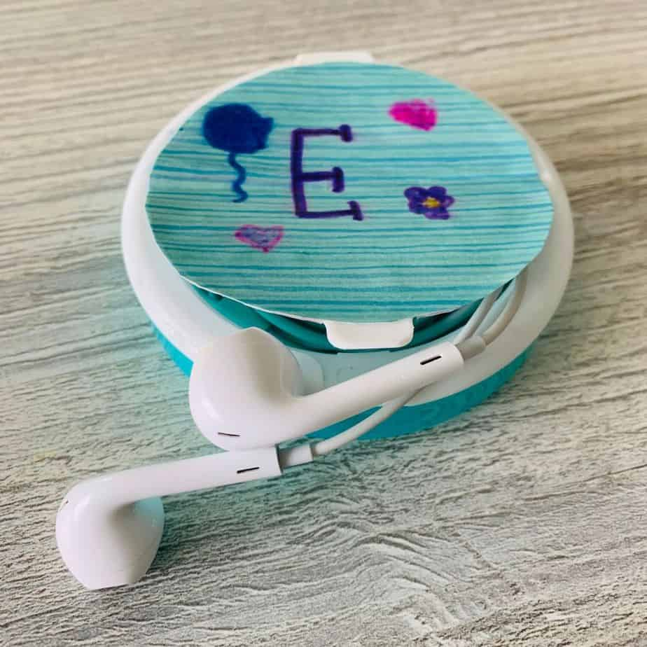 upcycled earbuds case made from a plastic mint container